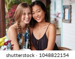 photo of pleased interracial... | Shutterstock . vector #1048822154
