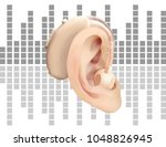 digital hearing aid behind the... | Shutterstock .eps vector #1048826945