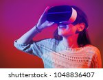 virtual reality glasses giving... | Shutterstock . vector #1048836407