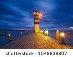 lighthouse at lake neusiedl ... | Shutterstock . vector #1048838807