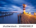 lighthouse at lake neusiedl ... | Shutterstock . vector #1048838819