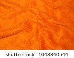 orange wrinked furry blanket...   Shutterstock . vector #1048840544