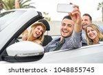 happy friends making a selfie... | Shutterstock . vector #1048855745