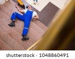 dead contractor worker felling... | Shutterstock . vector #1048860491