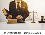 young lawyer hard working in... | Shutterstock . vector #1048861211