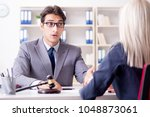 lawyer discussing legal case... | Shutterstock . vector #1048873061