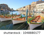 colorful traditional boats in... | Shutterstock . vector #1048880177