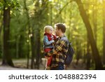 father and his little son... | Shutterstock . vector #1048882394
