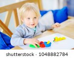 creative boy playing with...   Shutterstock . vector #1048882784