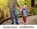 father and his little son... | Shutterstock . vector #1048882964