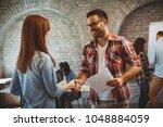 good news handshake in the... | Shutterstock . vector #1048884059