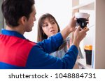 client getting securty camera... | Shutterstock . vector #1048884731