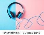 headphones on blue and pink... | Shutterstock . vector #1048891049