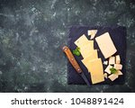 various type of sliced cheese.... | Shutterstock . vector #1048891424
