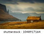 Lonely old cabin with grassy roof and Witch