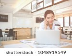 young asian woman working at a... | Shutterstock . vector #1048919549
