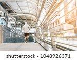 runner jogging training and...   Shutterstock . vector #1048926371