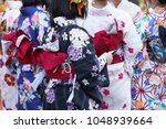 young girl wearing japanese... | Shutterstock . vector #1048939664