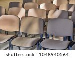 chairs in rows in a room | Shutterstock . vector #1048940564