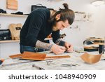 working process of the leather... | Shutterstock . vector #1048940909