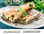 portion of cannelloni stuffed... | Shutterstock . vector #1048945589