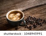 hot latte coffee in black cup... | Shutterstock . vector #1048945991