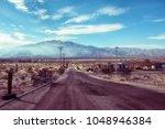 deserted abandoned empty road... | Shutterstock . vector #1048946384