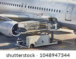 cargo containers loaded into an ... | Shutterstock . vector #1048947344