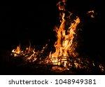 fire flames on a black...   Shutterstock . vector #1048949381