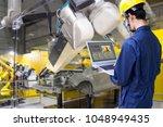 industry 4.0 robot concept ... | Shutterstock . vector #1048949435