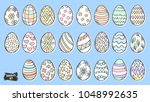 easter eggs doodle set. spring... | Shutterstock .eps vector #1048992635