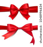 set of wrapped red bows and... | Shutterstock .eps vector #1048996634
