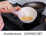 close up of hand cooking and... | Shutterstock . vector #1049001587