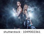 couple of muscular young people ... | Shutterstock . vector #1049002361