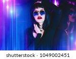 fashion shot. beautiful female... | Shutterstock . vector #1049002451