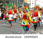 Women in clown costumes in Cyprus carnival parade. - stock photo