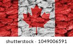 the texture of the flag canada... | Shutterstock . vector #1049006591