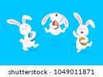 white rabbit holding easter egg ... | Shutterstock .eps vector #1049011871
