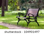 Stylish Bench In Summer Park