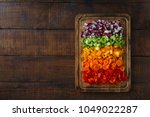 chopped fresh vegetables... | Shutterstock . vector #1049022287