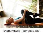 sporty woman doing exercises... | Shutterstock . vector #1049037539