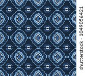 ikat geometric folklore... | Shutterstock .eps vector #1049056421
