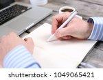 closeup of a business man... | Shutterstock . vector #1049065421