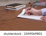 closeup of a business man... | Shutterstock . vector #1049069801