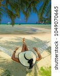 woman on a hammock at the beach ... | Shutterstock . vector #1049070665