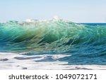 beautiful azure wave crest ... | Shutterstock . vector #1049072171