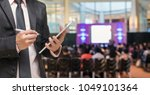 businessman using the tablet on ... | Shutterstock . vector #1049101364