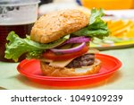 tasty hamburger with fresh... | Shutterstock . vector #1049109239