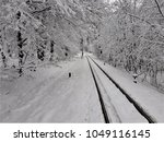 endless railway in the winter... | Shutterstock . vector #1049116145