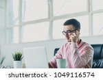 young man working on a project... | Shutterstock . vector #1049116574
